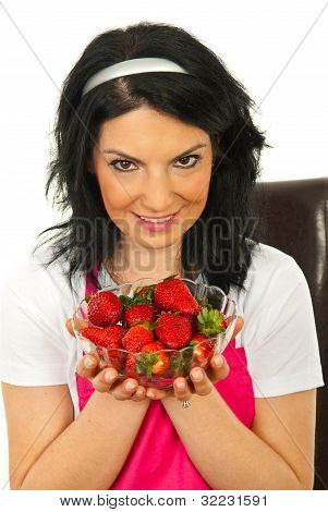 Beauty Woman Showing Bowl With Strawberries