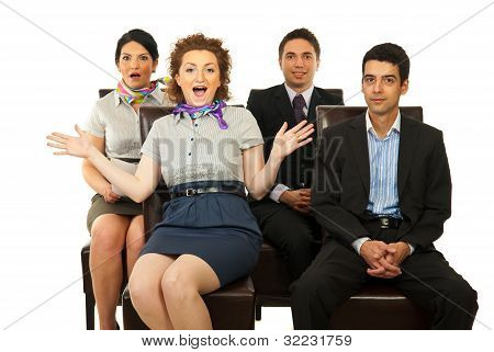 Amazed Business People On Chairs