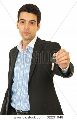 Business Man Giving House Key