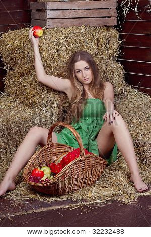 beautiful blonde country girl posing on yellow hay
