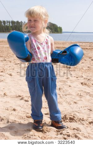 Toddler In Boxing Gloves