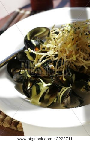 Bowl Of Mussells With Shoetring Potatos