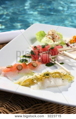 Sushi And Seafood Skewers Next To The Pool