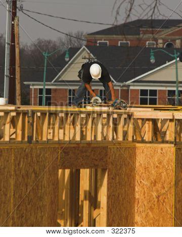 Carpenter Sawing