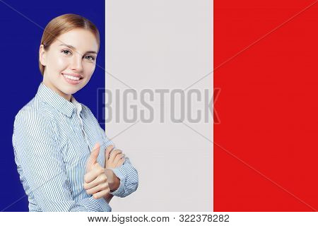 poster of Happy Woman Showing Thumb Up On French Flag Background. Travel In France And Study French Language