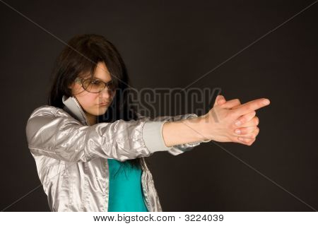 Fashion Girl Pointing Her Hands Like A Gun