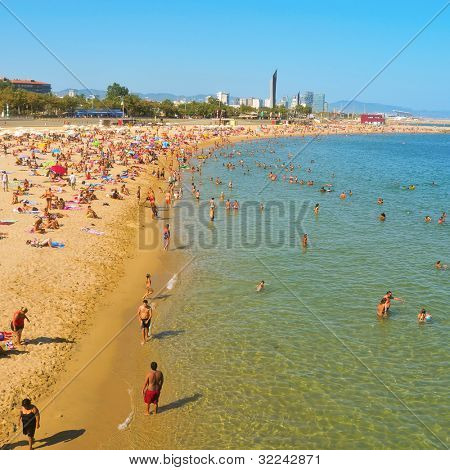 BARCELONA, SPAIN - AUGUST 16: La Nova Icaria Beach on August 16, 2011 in Barcelona, Spain. This beach, 400 meters long, arised with the urban redevelopment on the occasion of the 1992 Olympic Games