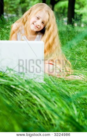 Smiling Little Girl With Laptop