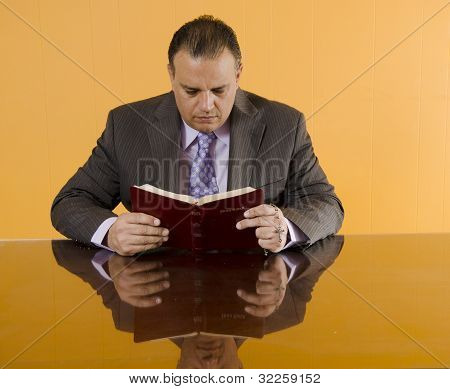 Religious Businessman Reading The Bible