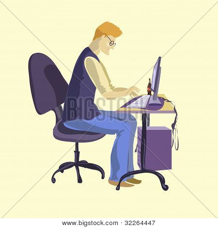 Young programmer sitting in front of his computer