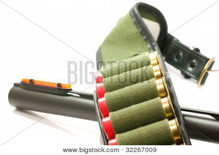 Close up on gun barrel and cartridge belt