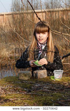 Teen Girl Recording Geocaching Logbook