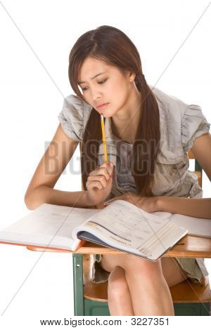 Asian College Student Preparing For Math Exam