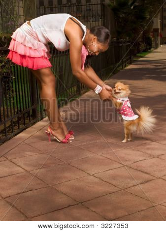 Black Woman Dancing With Pomeranian Spitz Dog (Focus On Dog)