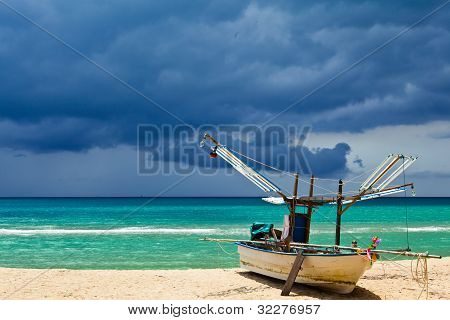 The fisherman boat on the beach
