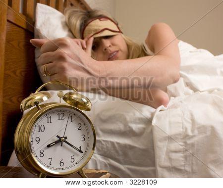 Woman And Alarm Clock
