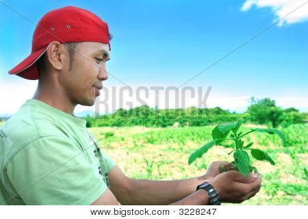 Man With Plant In Hand