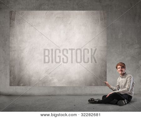 Young businessman holding a board