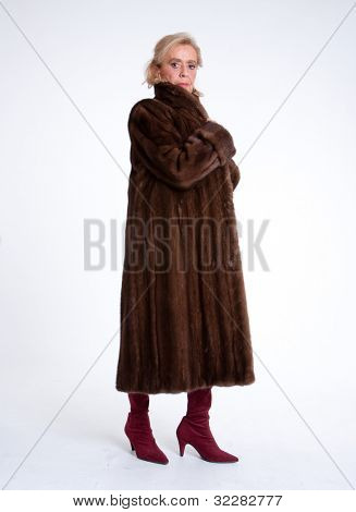 Senior lady wearing a mink coat