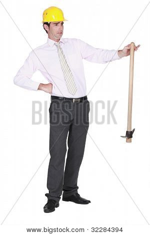 Architect sheepishly holding pick-axe