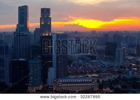 View of Singapore skyline in the evening at sunset.