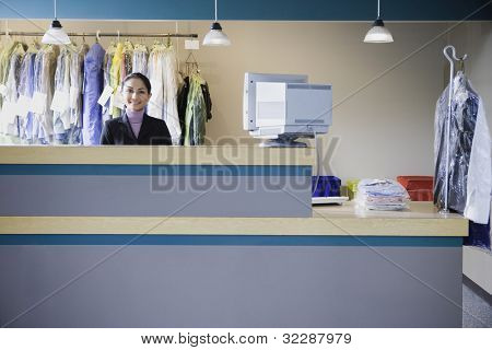 Asian businesswoman at drycleaner