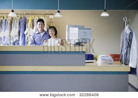Asian male and female drycleaners