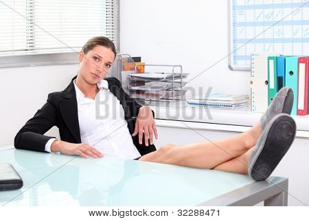Woman with feet on the table