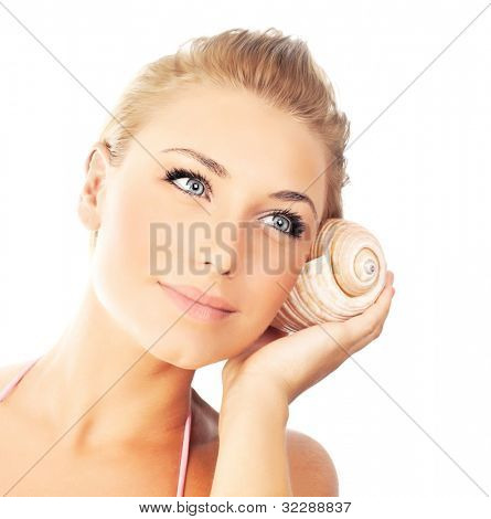 Young pretty woman with seashell, closeup female face portrait isolated on white background, calm girl enjoying sound, summer vacation and relaxation