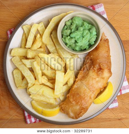 Fried cod fish, chips and mushy peas