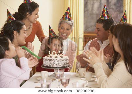 Family birthday party for Hispanic girl