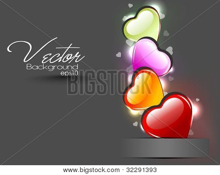 Glossy heart shapes design in red, yellow, green and pink color isolated on grey background. EPS 10, can be use as label, sticker, tag, button and icon.