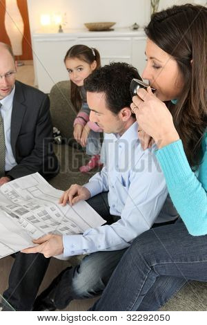Family having a meeting with their architect
