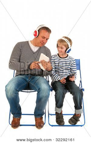 Father and son are together gaming with tablet PC