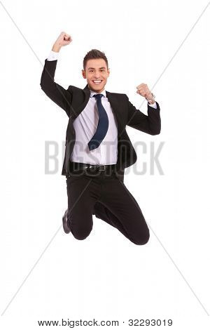 Excitement of business - Isolated shot of an extremely excited business man jumping in the air