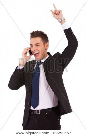 screaming young business man discussing on a cell phone and winning, isolated on white background