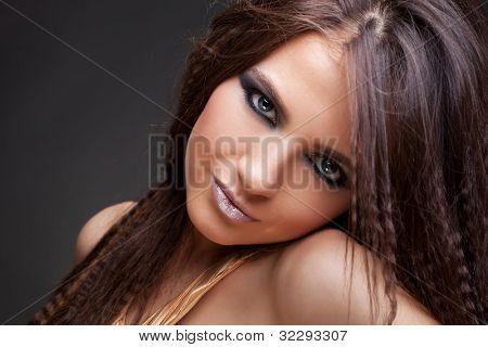 closeup picture of a beautiful  young woman's face and long hair