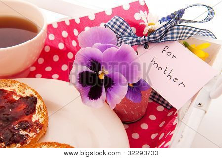 Tray with breakfast for mother with tea and biscuits