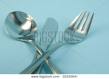 fork,knive and spoon isolated on blue background