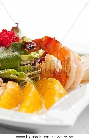 Seafoods - Shrimps, Sea Scallops, Squids and Salmon. Garnished with Fresh Raw Salad Leaf and Flying Fish Roe.