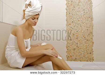 Beautiful woman body creme application - health and beauty