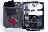 Business, Trip, Luggage And People Concept. Business Formal Wear Clothes Packed Into Travel Bag poster