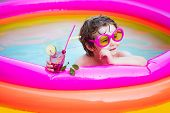 Happy Little Boy Relaxing In Pool. Smiling Cute Little Boy In Sunglasses In Pool In Sunny Day With C poster