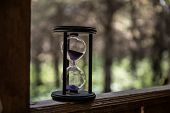 Sand Running Through The Bulbs Of An Hourglass Measuring The Passing Time In A Countdown To A Deadli poster