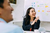 Asian Mature Business Woman Smiling And Looking At Other Business People While Sitting In Meeting. S poster