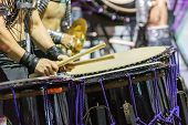 A Drummer Is Performing On The Stage. A Musician Is Drumming On The Drum Performance. Closeup View O poster