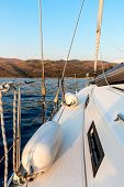 Evening On A Yacht Near The Croatian Island Of Brac. Yacht Bow At Sunset. Holiday In Croatia. poster