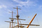 Masts, Sail Yards With The Lowered Sails And Rigging Of A Sailing Ship Against A Clear Blue Sky With poster