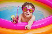 Children Playing In Pool. Child Water Toys. Stylish Sunglasses. Beach Clubs In Ibiza. Beach Party. C poster