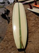 image of grommets  - Vintage Surfboard on the beach at a surf competition - JPG